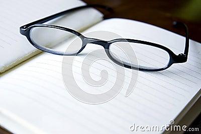 Eyeglasses on notebook