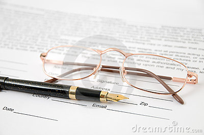 Eyeglasses and pen