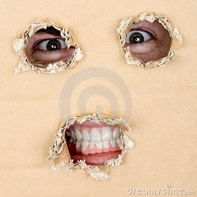 Free Eyes And Teeth Look Out From Hole Royalty Free Stock Image - 7769096