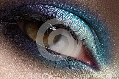 Eyes cosmetic, eyeshadow. Closeup fashion make-up