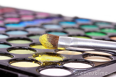 Eyeshadows with professional make-up brush on yell