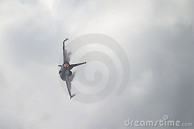 F-16 Jet with Afterburner On and Vapor Clouds Forming on Wings
