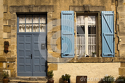 Facade with blue door and shutter