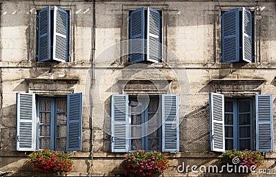 Facade blue windows flowers Brantome France