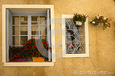 Facade flowers blue window  Brantome France