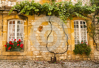 Facade with flowers Monpazier