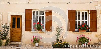 Facade with flowers Saint Jean de Cole