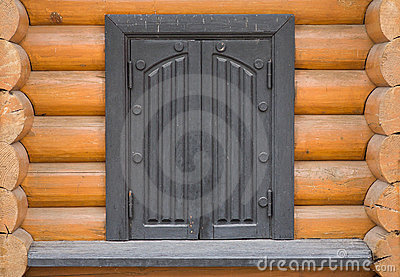 Facade of log house with window