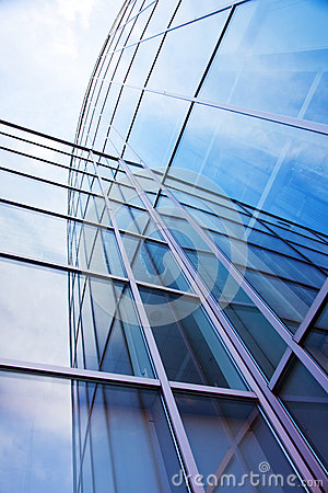 Facade of modern glass blue office and sky
