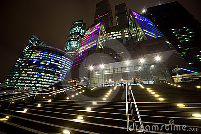 Facade of modern office building at night