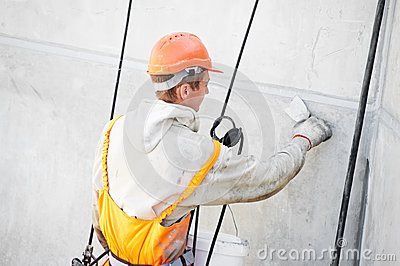 Facade Plasterer worker at work