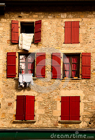 Facade with red wood shutters