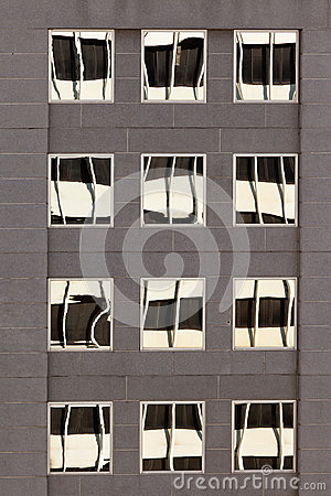 Facade with reflections of building on windows