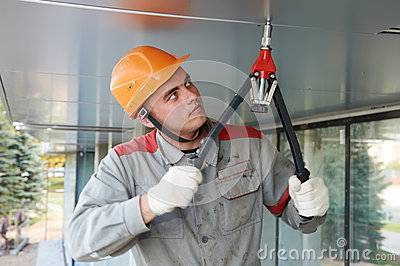 Facade worker with rivet tool