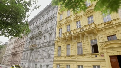 Facades of multi colored traditional classic buildings in european city. Moving shot stock video