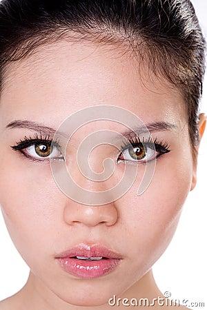 Face asiática da mulher