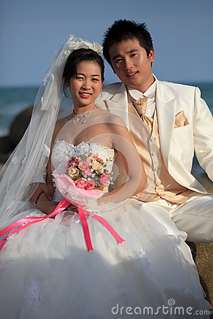 Face of asian Bride and groom with flowers in hand
