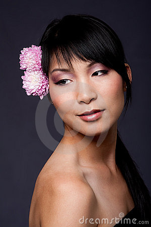 Face of Asian woman with flowers