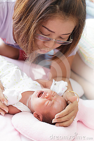 Face of baby infant and mother