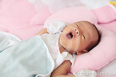 Face of baby infant wake up