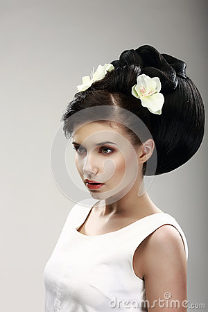 Face of Beautiful Brunette Bride Fashion Model. Elegant Hairdo with Vernal Flowers