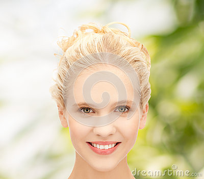 Face of beautiful smiling teenage girl