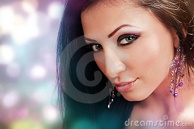 Face of beautiful woman with colorful make-up