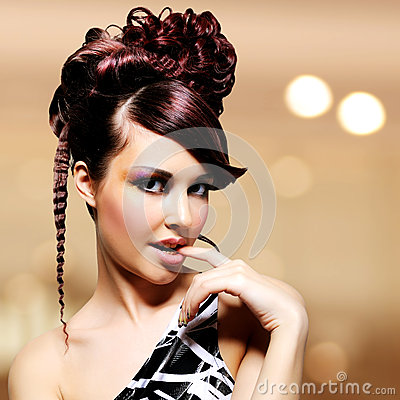 Face of beautiful woman with fashion hairstyle and glamour makeu