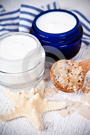 Face cream in jars with sea salt and star