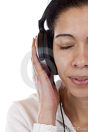 Face cut of a woman listening to mp3 music