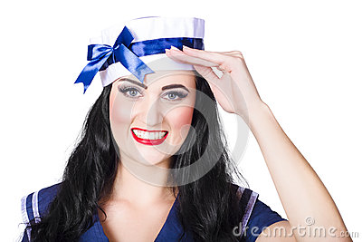 Face of a cute pinup girl saluting in sailor style