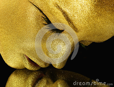 Face with gold glitter