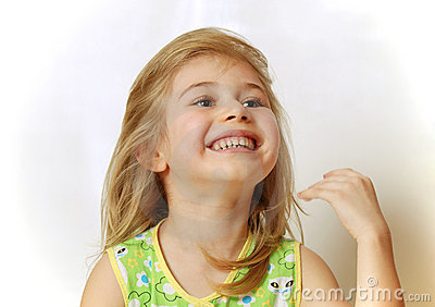 Face of little blond girl laughing