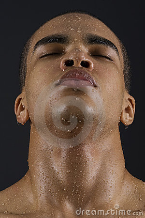 Face of man with water drops