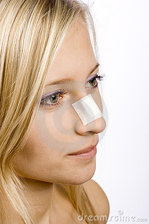 Free Face Of Young Woman With Sticking Plaster On Nose Royalty Free Stock Photography - 1417057