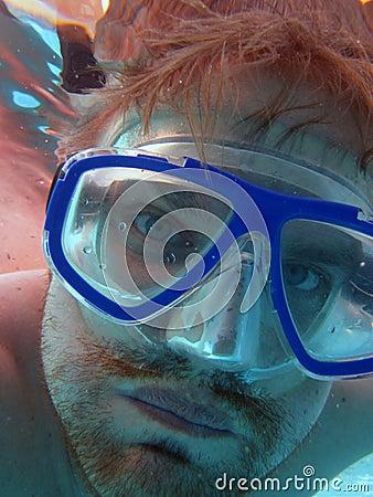 Face of scuba diver