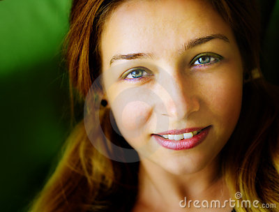 Face of sensual cute friendly young woman