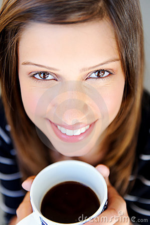 Face of woman with coffee