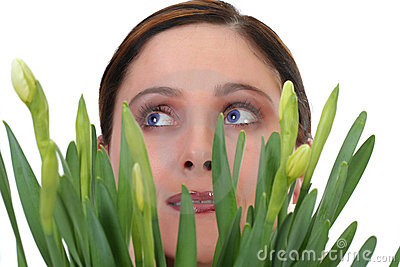 Face of a woman with daffodils
