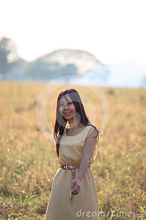 face of women standing in the grass field with ev