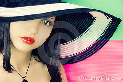 Face of  young beautiful brunette in hat