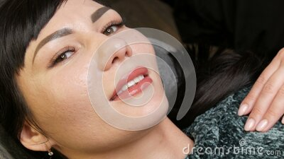 Face of a young beautiful woman. Final result of permanent tattoo lip makeup. Light matte pink lips close up. lips. Microblading procedure stock footage