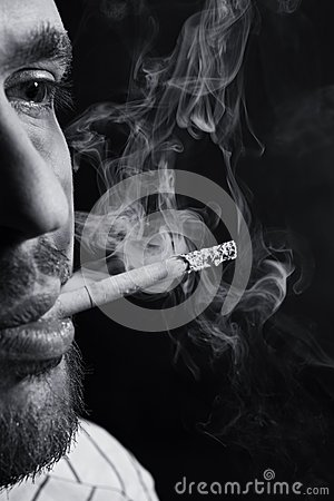 Face of a young man with a cigarette
