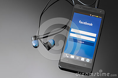 Facebook application on smart phone screen. Editorial Photography