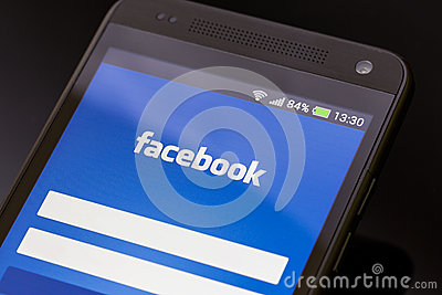 Facebook application on smart phone screen. Editorial Photo