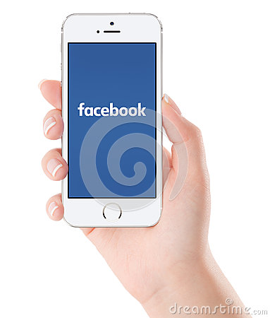 Free Facebook Logo On White Apple IPhone 5s Display In Female Hand Stock Photos - 56978813