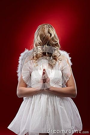 Faceless angel praying