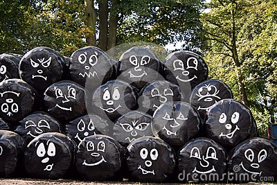 Faces on black bags
