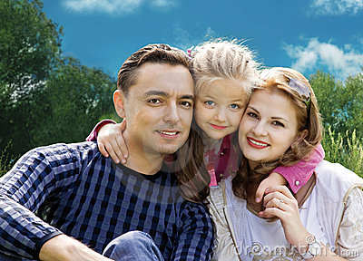 Faces family with little girl in park collage