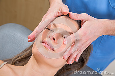 Facial massage relaxing theraphy on woman face